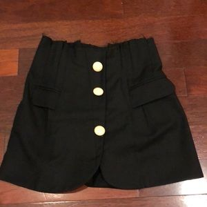 Jacqumus style mini skirt with wool and button
